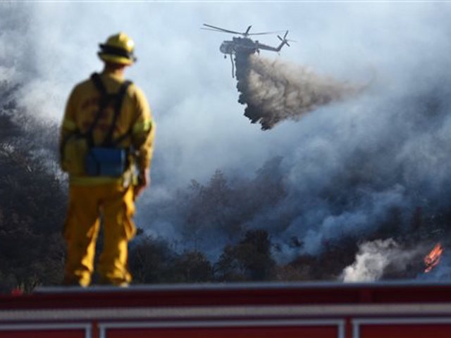 Crews make gains against big California wildfire