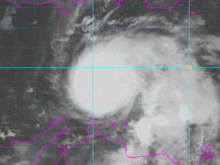 Hurricane Matthew downgraded, kills at least 2