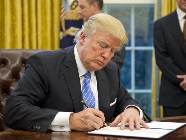 Trump signs law rolling back U.S. abortion clinics funding protection