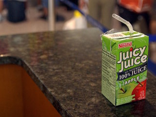 Does 100-percent fruit juice add pounds to kids?