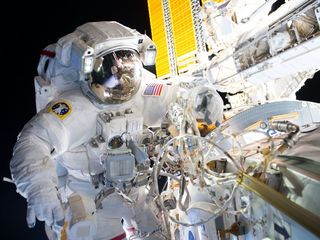 Spacewalk prepares ISS for commercial crew