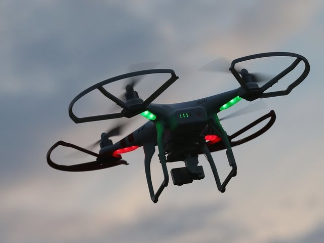 Three arrested for using drone to drop phone, drugs into MI prison