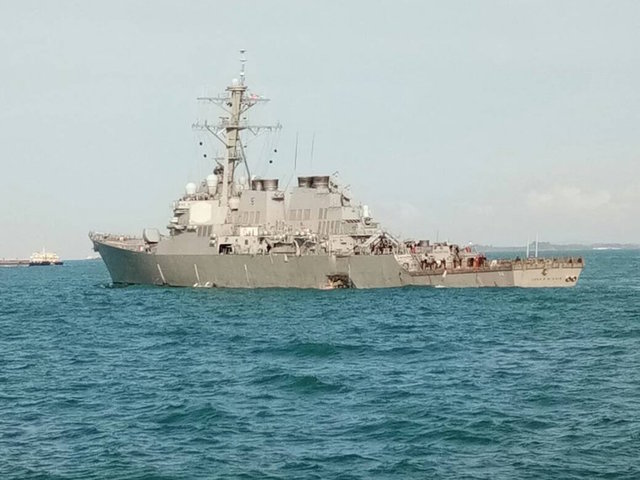 USS John S. Mc Cain with hole on side  Twitter/@mykamarul