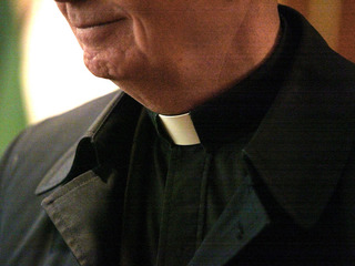 Okemos priest accused of embezzlement in court
