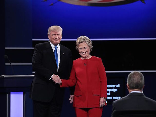 ... nominee Hillary Clinton shake hands prior to the start of the  Presidential Debate at Hofstra University on September 26, 2016 in  Hempstead, New York.