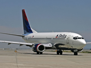 Delta in trouble with China over Tibet, Taiwan