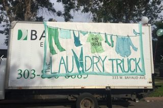 Mobile laundromat washes clothes for homeless