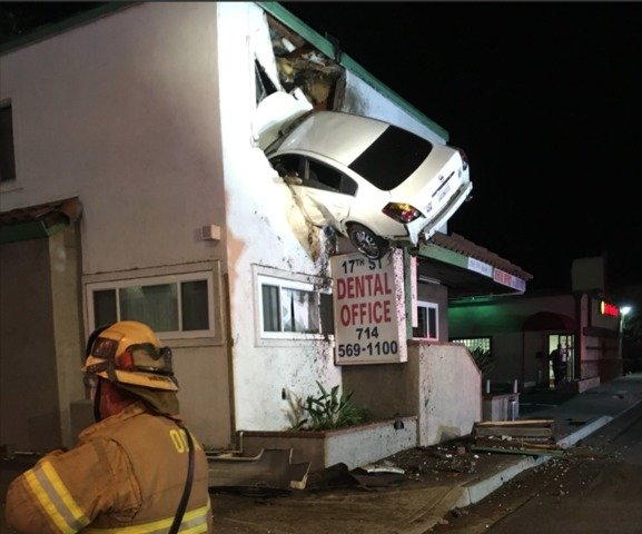 Airborne auto slams into 2nd floor of California building